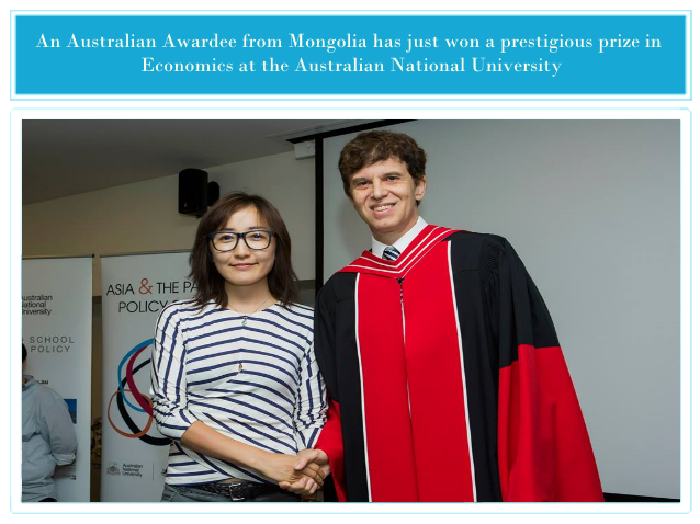 Ms. B. Tsendsuren shaking hands with Prof Tom Kompas, Director of Crawford School of Public Policy and Director of Australian Centre for biosecurity and Environmental Economics (ACBEE) after winning the Helen Hughes Graduate Diploma Prize, achieving the highest results among all other scholars studying Economics at the Crawford School of Public Policy of Australian National University.